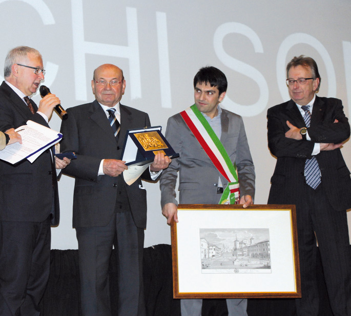 Premio Bellunesi nel Mondo a Cortina, anno 2012. Da sinistra il senatore Gianvittore Vaccari, Gianfranco Pittarel, il sindaco di Feltre Paolo Perenzin e il presidente Abm Oscar De Bona.